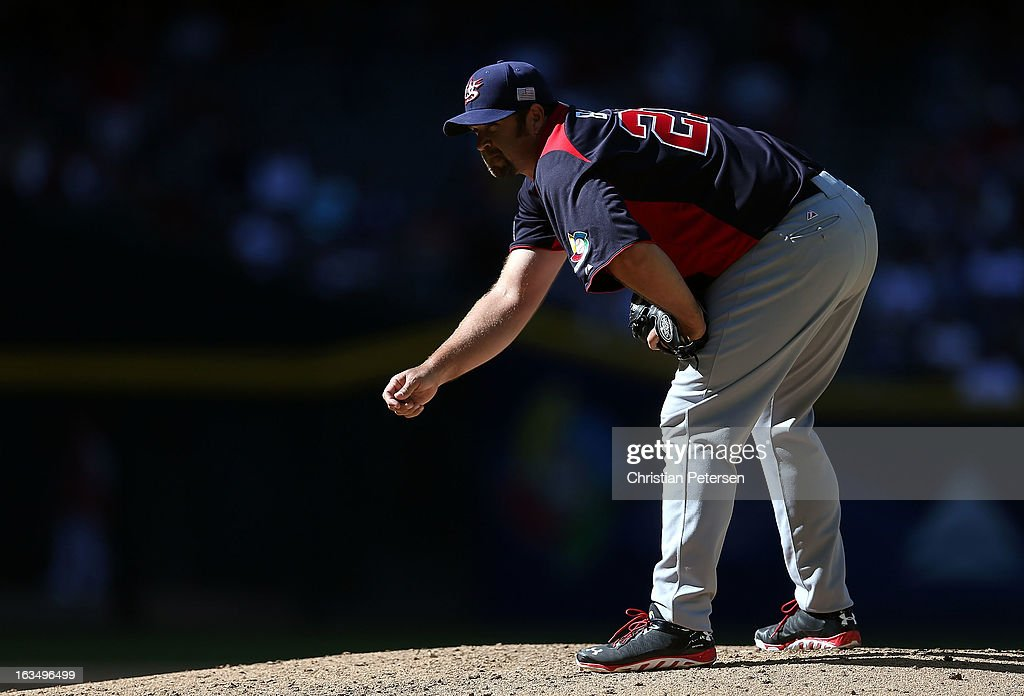 Relief pitcher <a gi-track='captionPersonalityLinkClicked' href=/galleries/search?phrase=Heath+Bell&family=editorial&specificpeople=243211 ng-click='$event.stopPropagation()'>Heath Bell</a> #21 of USA prepares to throw a ptich to Canada during the World Baseball Classic First Round Group D game at Chase Field on March 10, 2013 in Phoenix, Arizona. USA defeated Canada 9-4.