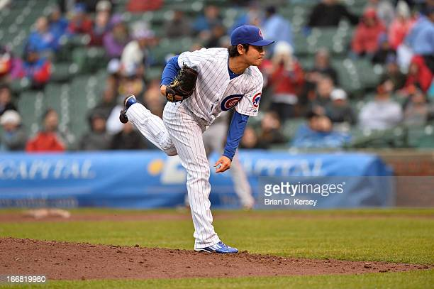 Relief pitcher Hisanori Takahashi of the Chicago Cubs delivers against the San Francisco Giants at Wrigley Field on April 11 2013 in Chicago Illinois...