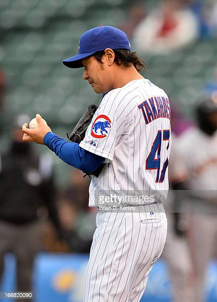 Relief pitcher Hisanori Takahashi of the Chicago Cubs stands on the field against the San Francisco Giants at Wrigley Field on April 11 2013 in...