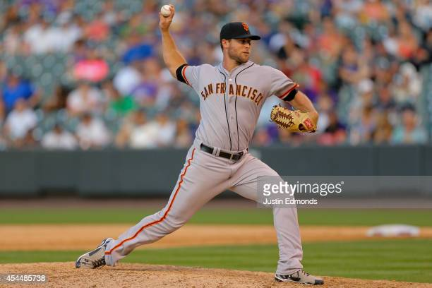 Relief pitcher Hunter Strickland of the San Francisco Giants delivers to home plate during the eighth inning against the Colorado Rockies at Coors...