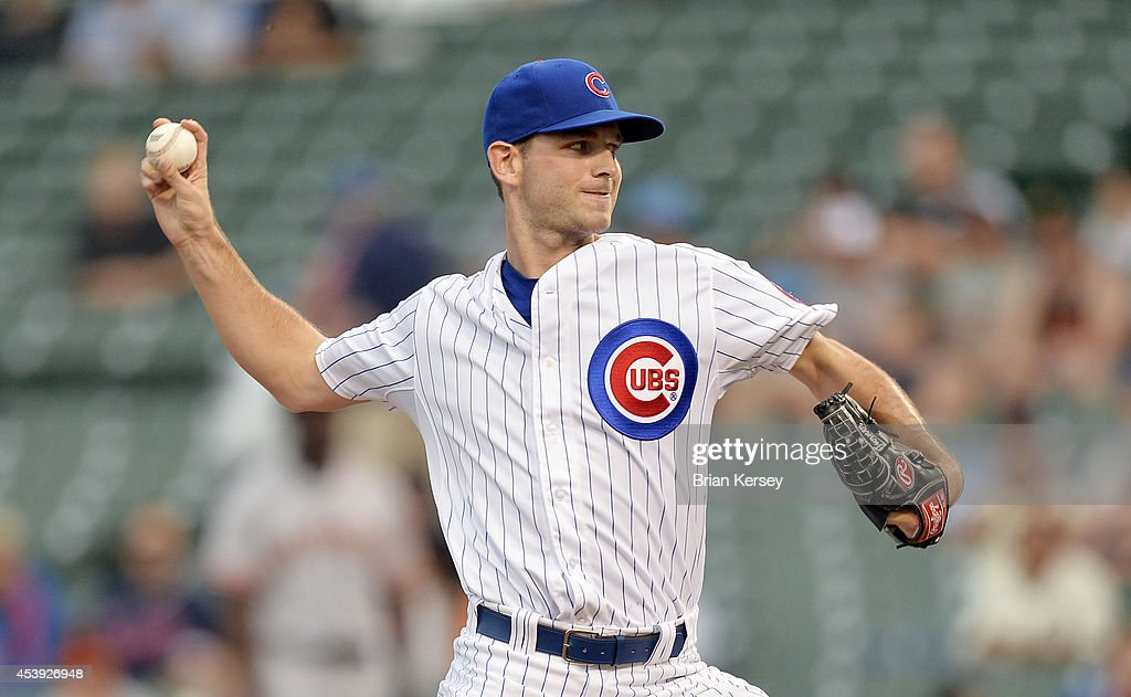 Relief pitcher <a gi-track='captionPersonalityLinkClicked' href=/galleries/search?phrase=Jacob+Turner+-+Baseball+Player&family=editorial&specificpeople=6265113 ng-click='$event.stopPropagation()'>Jacob Turner</a> #38 of the Chicago Cubs delivers a pitch during the fifth inning of a resumed game against the San Francisco Giants at Wrigley Field on August 21, 2014 in Chicago, Illinois. The game was initially called off in the early morning hours of August 20 over a protest from the Giants. Major League Baseball accepted the Giants' appeal, ruling the delay was caused by a mechanical failure of the tarp and changing the status of the game from cancelled and completed with a Cubs 2-0 win to a suspended game.