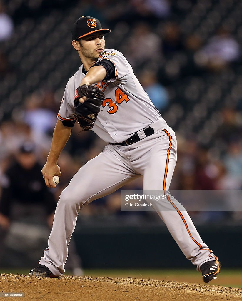 Relief pitcher <a gi-track='captionPersonalityLinkClicked' href=/galleries/search?phrase=Jake+Arrieta&family=editorial&specificpeople=5437045 ng-click='$event.stopPropagation()'>Jake Arrieta</a> #34 of the Baltimore Orioles pitches against the Seattle Mariners at Safeco Field on September 18, 2012 in Seattle, Washington.
