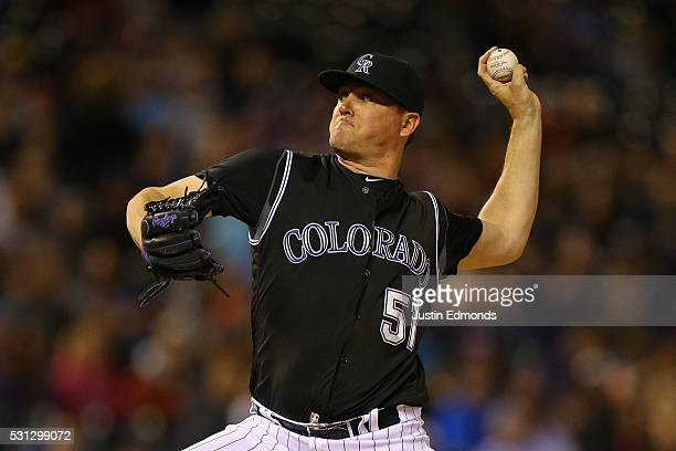 Relief pitcher Jake McGee of the Colorado Rockies delivers to home plate during the ninth inning against the New York Mets at Coors Field on May 13...