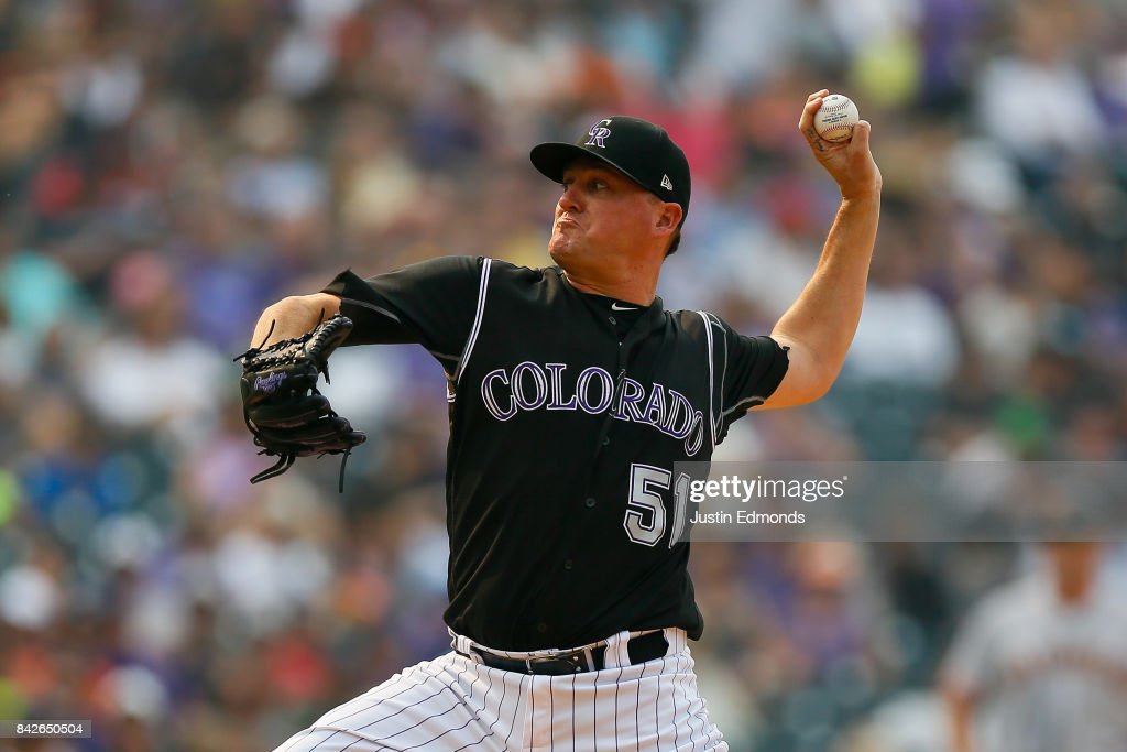 Relief pitcher Jake McGee #51 of the Colorado Rockies delivers to home plate during the eighth inning against the San Francisco Giants at Coors Field on September 4, 2017 in Denver, Colorado. The Rockies defeated the Giants 4-3.