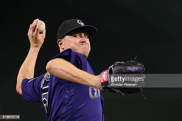 Relief pitcher Jake McGee of the Colorado Rockies throws a warm up pitch during the MLB game against the Arizona Diamondbacks at Chase Field on April...