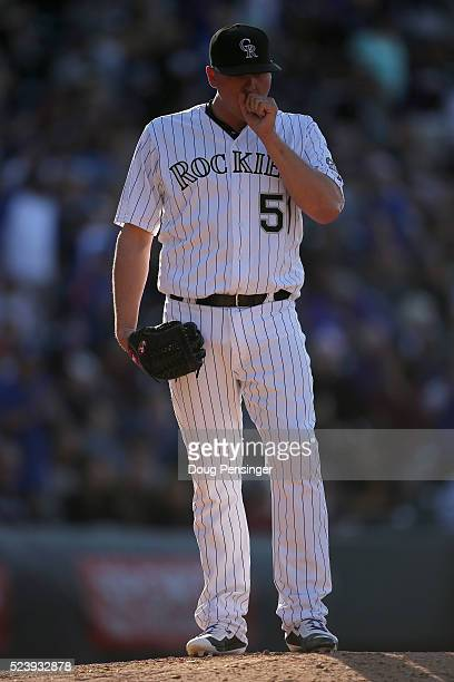 Relief pitcher Jake McGee of the Colorado Rockies works against the Los Angeles Dodgers as he blows the save and collects the loss at Coors Field on...