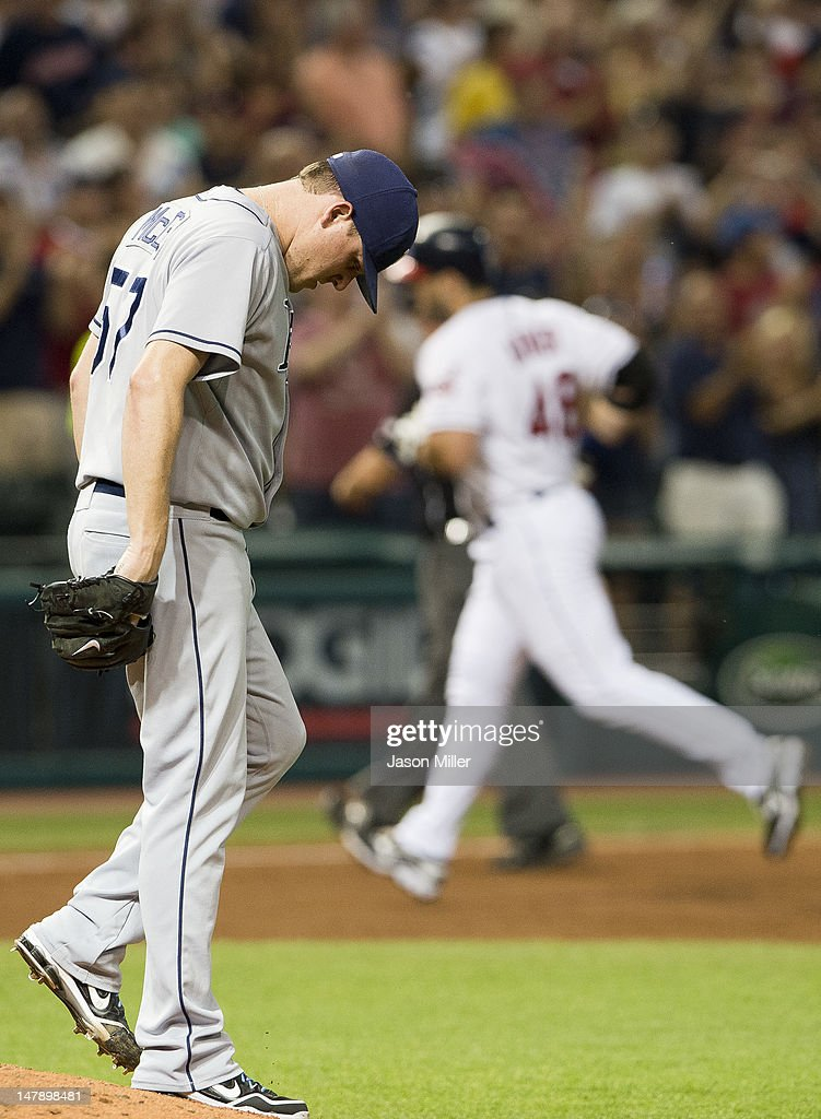 Relief pitcher <a gi-track='captionPersonalityLinkClicked' href=/galleries/search?phrase=Jake+McGee+-+Baseball+Player&family=editorial&specificpeople=15096866 ng-click='$event.stopPropagation()'>Jake McGee</a> #57 of the Tampa Bay Rays hangs his head after giving up a home run to <a gi-track='captionPersonalityLinkClicked' href=/galleries/search?phrase=Travis+Hafner&family=editorial&specificpeople=220556 ng-click='$event.stopPropagation()'>Travis Hafner</a> #48 of the Cleveland Indians during the eighth inning at Progressive Field on July 5, 2012 in Cleveland, Ohio. The Indians defeated the Rays 3-1.
