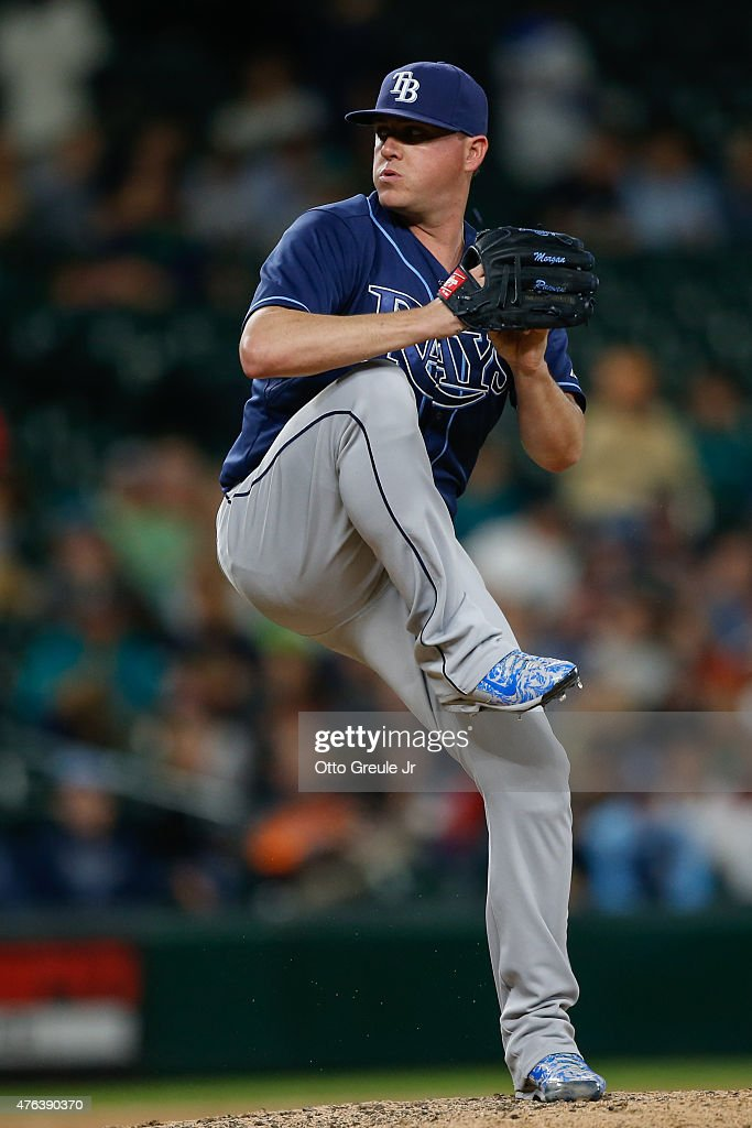 Relief pitcher <a gi-track='captionPersonalityLinkClicked' href=/galleries/search?phrase=Jake+McGee+-+Baseball+Player&family=editorial&specificpeople=15096866 ng-click='$event.stopPropagation()'>Jake McGee</a> #57 of the Tampa Bay Rays pitches against the Seattle Mariners at Safeco Field on June 4, 2015 in Seattle, Washington.