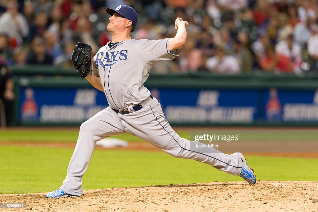 Relief pitcher <a gi-track='captionPersonalityLinkClicked' href=/galleries/search?phrase=Jake+McGee+-+Baseball+Player&family=editorial&specificpeople=15096866 ng-click='$event.stopPropagation()'>Jake McGee</a> #57 of the Tampa Bay Rays pitches during the eighth inning against the Cleveland Indians at Progressive Field on June 19, 2015 in Cleveland, Ohio.