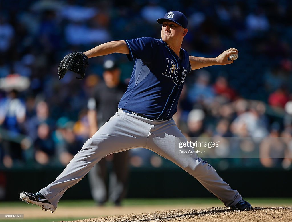 Relief pitcher <a gi-track='captionPersonalityLinkClicked' href=/galleries/search?phrase=Jake+McGee+-+Baseball+Player&family=editorial&specificpeople=15096866 ng-click='$event.stopPropagation()'>Jake McGee</a> #57 of the Tampa Bay Rays pitches in the seventh inning against the Seattle Mariners at Safeco Field on September 8, 2013 in Seattle, Washington. The Rays defeated the Mariners 4-1.