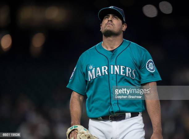 Relief pitcher James Pazos of the Seattle Mariners walks off the field during a game against the Tampa Bay Rays at Safeco Field on June 2 2017 in...
