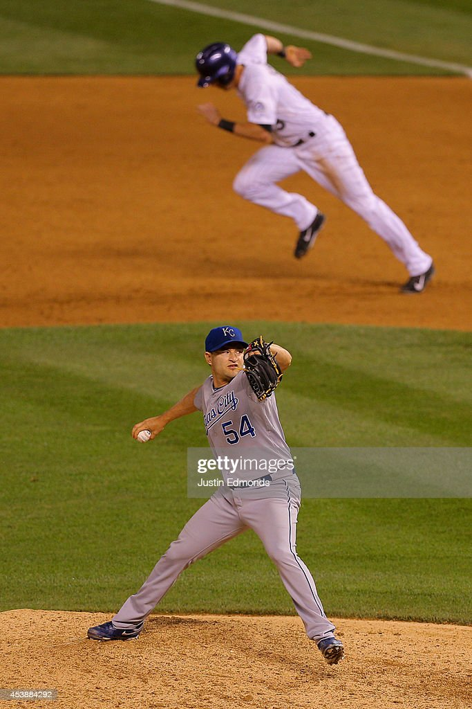 Relief pitcher <a gi-track='captionPersonalityLinkClicked' href=/galleries/search?phrase=Jason+Frasor&family=editorial&specificpeople=213654 ng-click='$event.stopPropagation()'>Jason Frasor</a> #54 of the Kansas City Royals delivers to home plate during the eighth inning as <a gi-track='captionPersonalityLinkClicked' href=/galleries/search?phrase=Drew+Stubbs+-+Baseball+Player&family=editorial&specificpeople=4498334 ng-click='$event.stopPropagation()'>Drew Stubbs</a> #13 of the Colorado Rockies attempts to steal second base at Coors Field on August 20, 2014 in Denver, Colorado. Stubbs returned to first base after a fly out. The Rockies defeated the Royals 5-2.