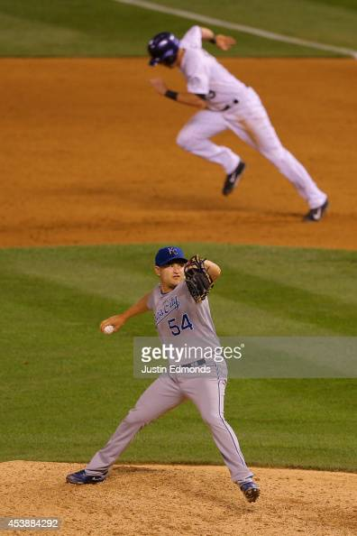 Relief pitcher Jason Frasor of the Kansas City Royals delivers to home plate during the eighth inning as Drew Stubbs of the Colorado Rockies attempts...