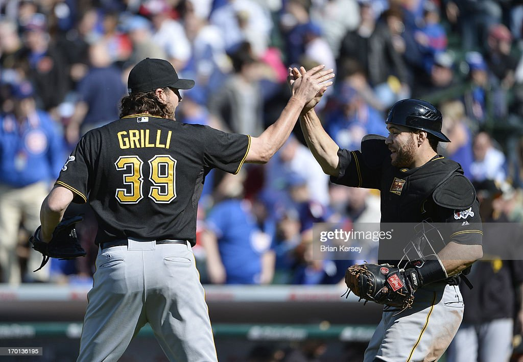 Relief pitcher <a gi-track='captionPersonalityLinkClicked' href=/galleries/search?phrase=Jason+Grilli&family=editorial&specificpeople=615724 ng-click='$event.stopPropagation()'>Jason Grilli</a> #39 of the Pittsburgh Pirates and catcher <a gi-track='captionPersonalityLinkClicked' href=/galleries/search?phrase=Russell+Martin+-+Baseball+Player&family=editorial&specificpeople=13764024 ng-click='$event.stopPropagation()'>Russell Martin</a> #55 celebrate a win over the Chicago Cubs at Wrigley Field on June 7, 2013 in Chicago, Illinois. The Pirates defeated the Cubs 2-0.