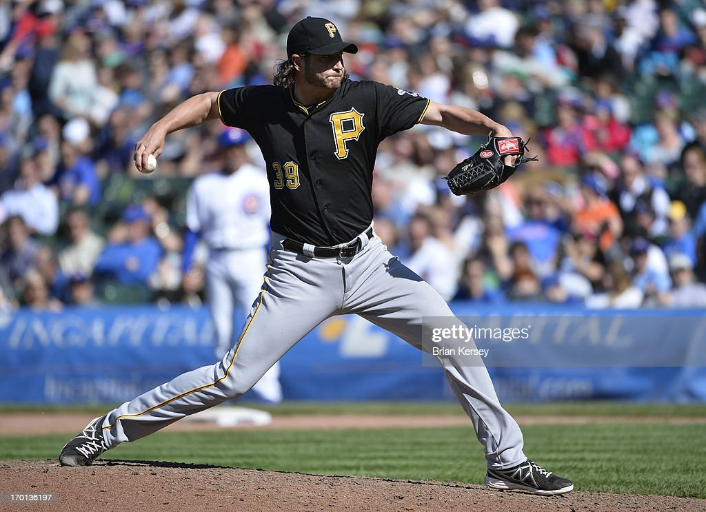 Relief pitcher <a gi-track='captionPersonalityLinkClicked' href=/galleries/search?phrase=Jason+Grilli&family=editorial&specificpeople=615724 ng-click='$event.stopPropagation()'>Jason Grilli</a> #39 of the Pittsburgh Pirates delivers during the ninth inning against the Chicago Cubs at Wrigley Field on June 7, 2013 in Chicago, Illinois. The Pirates defeated the Cubs 2-0.