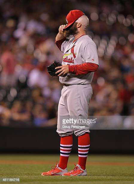 Relief pitcher Jason Motte of the St Louis Cardinals reacts as he works against the Colorado Rockies in the eighth inning at Coors Field on June 24...