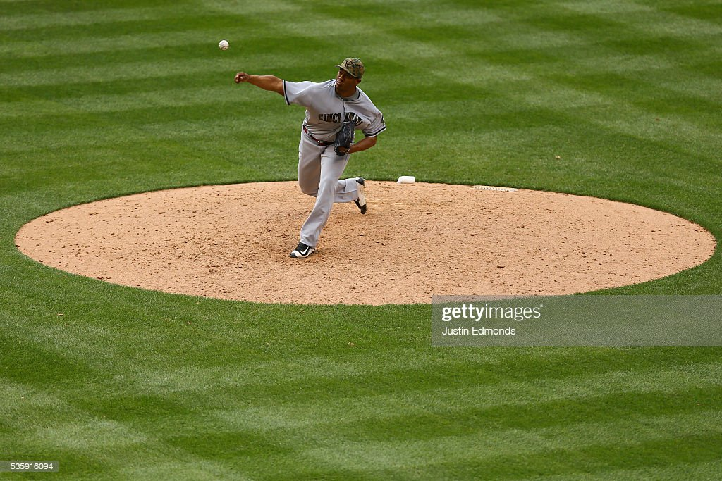 Relief pitcher JC Ramirez #66 of the Cincinnati Reds delivers to home plate during the ninth inning against the Colorado Rockies at Coors Field on May 30, 2016 in Denver, Colorado. Ramirez earned his first career save as the Reds defeated the Rockies 11-8.