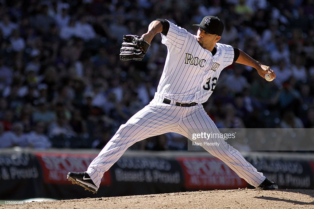 Relief pitcher JC Romero of the Colorado Rockies pitches against the San Francisco Giants during their game at Coors Field on Sunday September 18...