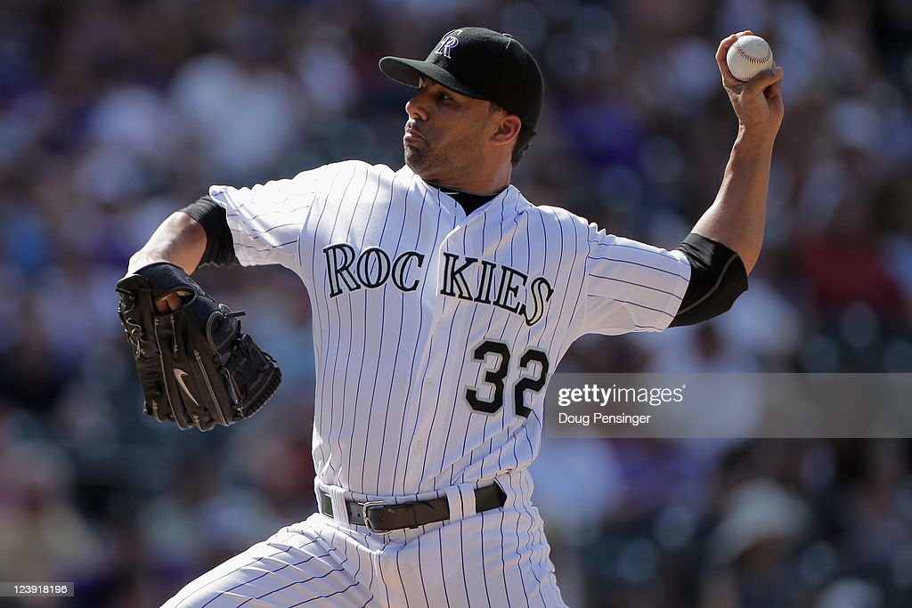Relief pitcher JC Romero of the Colorado Rockies works against the Arizona Diamondbacks at Coors Field on September 5 2011 in Denver Colorado