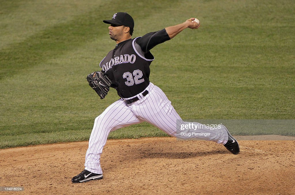 Relief pitcher JC Romero of the Colorado Rockies works against the Arizona Diamondbacks at Coors Field on September 7 2011 in Denver Colorado