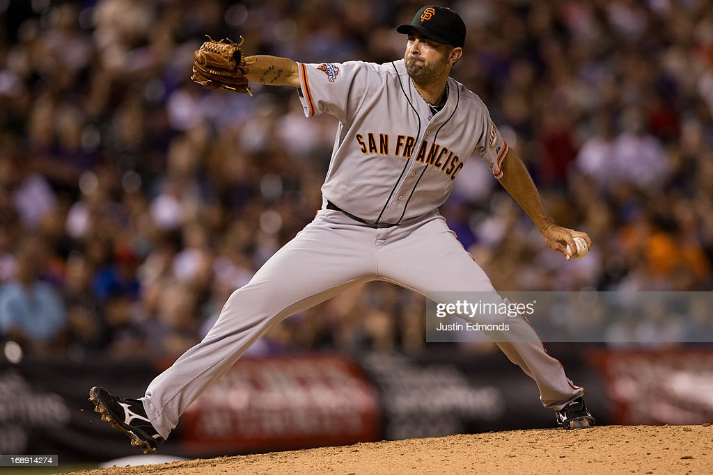 Relief pitcher <a gi-track='captionPersonalityLinkClicked' href=/galleries/search?phrase=Jeremy+Affeldt&family=editorial&specificpeople=214238 ng-click='$event.stopPropagation()'>Jeremy Affeldt</a> #41 of the San Francisco Giants delivers to home plate during the seventh inning against the Colorado Rockies at Coors Field on May 16, 2013 in Denver, Colorado. The Giants defeated the Rockies 8-6.