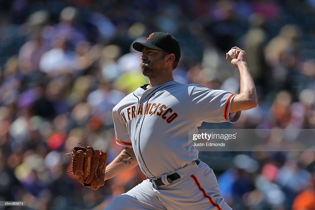 Relief pitcher Jeremy Affeldt #41 of the San Francisco Giants delivers to home plate during the sixth inning against the Colorado Rockies at Coors Field on September 1, 2014 in Denver, Colorado. The teams were resuming a game previously suspended in the sixth inning on May 22 due to rain.