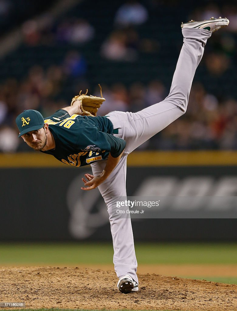 Relief pitcher Jerry Blevins #13 of the Oakland Athletics follows through on a pitch against the Seattle Mariners at Safeco Field on June 22, 2013 in Seattle, Washington.