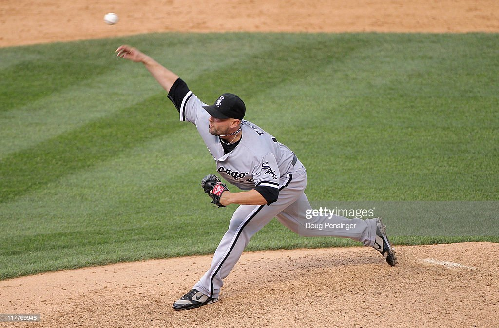 Relief pitcher <a gi-track='captionPersonalityLinkClicked' href=/galleries/search?phrase=Jesse+Crain&family=editorial&specificpeople=234841 ng-click='$event.stopPropagation()'>Jesse Crain</a> #26 of the Chicago White Sox delivers against the Colorado Rockies during Interleague play at Coors Field on June 30, 2011 in Denver, Colorado. Crain earned the win as the White Sox defeated the Rockies 6-4 in 10 innings.