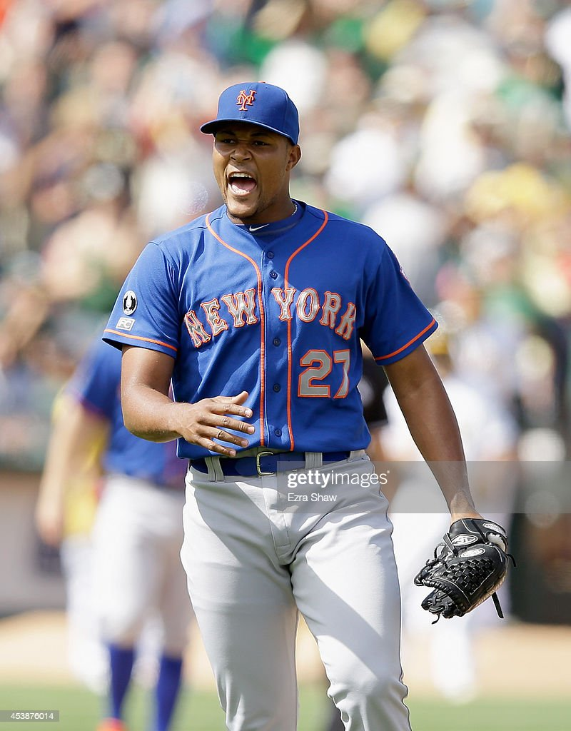 Relief pitcher <a gi-track='captionPersonalityLinkClicked' href=/galleries/search?phrase=Jeurys+Familia&family=editorial&specificpeople=8992911 ng-click='$event.stopPropagation()'>Jeurys Familia</a> #27 of the New York Mets reacts after Josh Donaldson #20 of the Oakland Athletics grounded out with the bases loaded to end the eighth inning at O.co Coliseum on August 20, 2014 in Oakland, California.