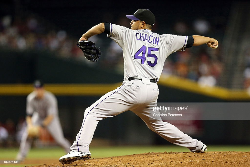 Relief pitcher <a gi-track='captionPersonalityLinkClicked' href=/galleries/search?phrase=Jhoulys+Chacin&family=editorial&specificpeople=5734320 ng-click='$event.stopPropagation()'>Jhoulys Chacin</a> #45 of the Colorado Rockies pitches against the Arizona Diamondbacks during the MLB game at Chase Field on October 2, 2012 in Phoenix, Arizona.