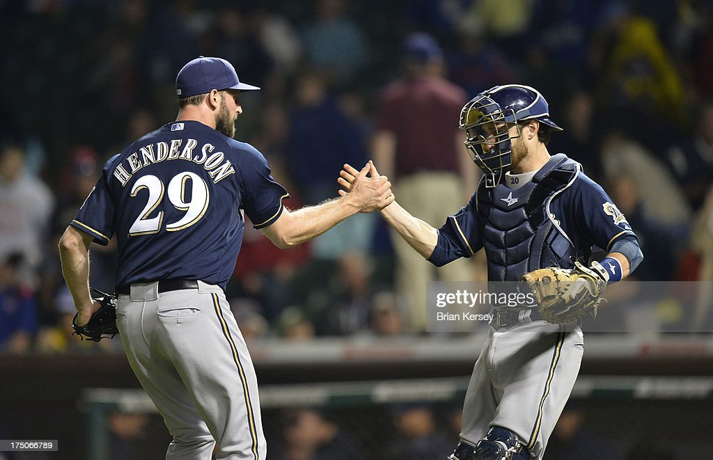 Relief pitcher Jim Henderson #29 (L) and catcher <a gi-track='captionPersonalityLinkClicked' href=/galleries/search?phrase=Jonathan+Lucroy&family=editorial&specificpeople=5732413 ng-click='$event.stopPropagation()'>Jonathan Lucroy</a> #20 of the Milwaukee Brewers celebrate their win over the Chicago Cubs after Game Two of a double header at Wrigley Field on July 30, 2013 in Chicago, Illinois. The Brewers defeated the Cubs 3-2.