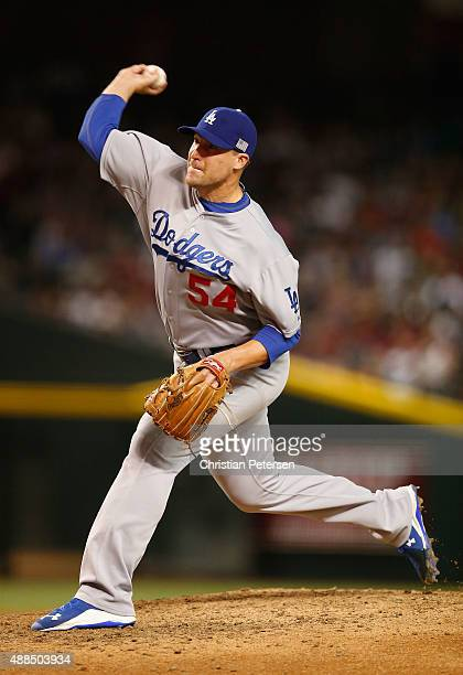 Relief pitcher Jim Johnson of the Los Angeles Dodgers pitches against the Arizona Diamondbacks during the MLB game at Chase Field on September 11...