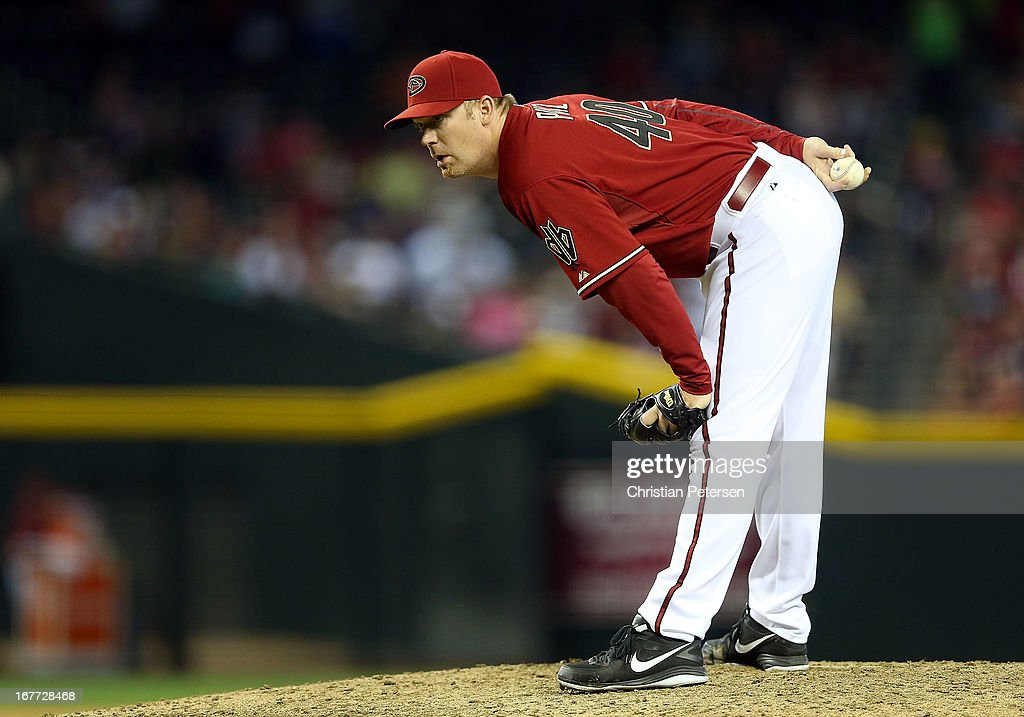 Relief pitcher <a gi-track='captionPersonalityLinkClicked' href=/galleries/search?phrase=J.J.+Putz&family=editorial&specificpeople=243125 ng-click='$event.stopPropagation()'>J.J. Putz</a> #40 of the Arizona Diamondbacks prepares to throw a pitch against the Colorado Rockies during the ninth inning of the MLB game at Chase Field on April 28, 2013 in Phoenix, Arizona. The Diamondbacks defeated the Rockies 4-2.