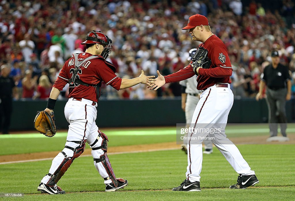 Relief pitcher <a gi-track='captionPersonalityLinkClicked' href=/galleries/search?phrase=J.J.+Putz&family=editorial&specificpeople=243125 ng-click='$event.stopPropagation()'>J.J. Putz</a> #40 of the Arizona Diamondbacks shakes hands with catcher <a gi-track='captionPersonalityLinkClicked' href=/galleries/search?phrase=Miguel+Montero&family=editorial&specificpeople=836495 ng-click='$event.stopPropagation()'>Miguel Montero</a> #26 after defeating the Colorado Rockies 4-2 in the MLB game at Chase Field on April 28, 2013 in Phoenix, Arizona.
