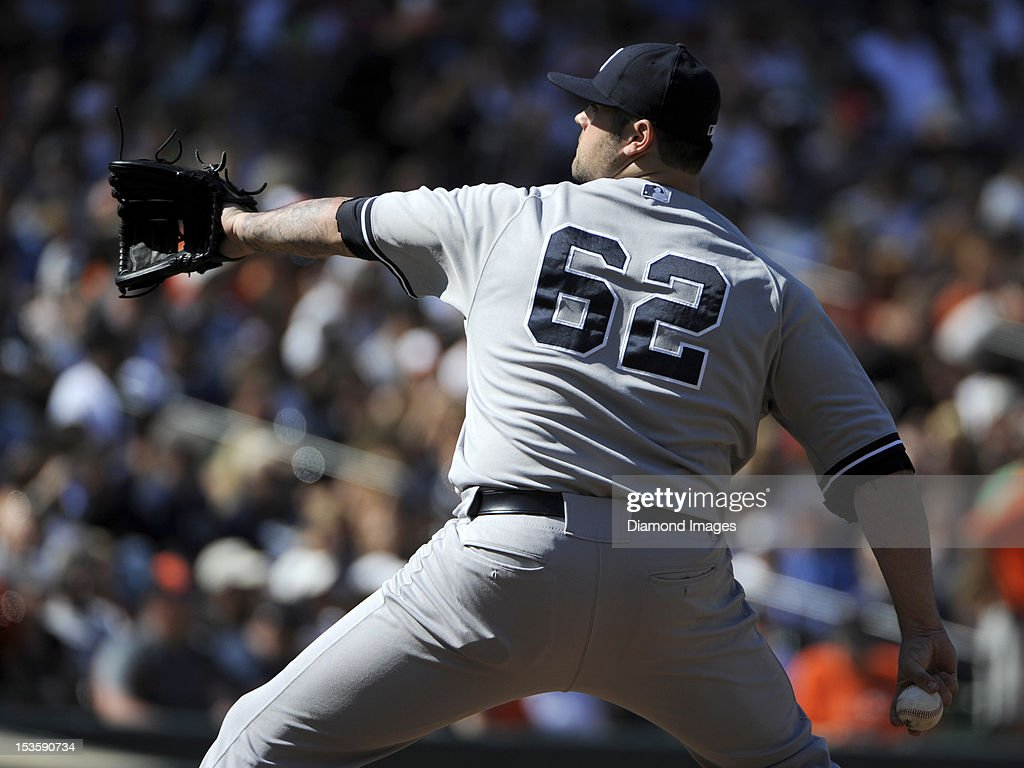 Relief pitcher Joba Chamberlain #62 of the New York Yankees throws a pitch during the bottom of the fourth inning of a game on September 9, 2012 against the Baltimore Orioles at Oriole Park in Baltimore, MD. The Yankees beat the Orioles, 13-3.