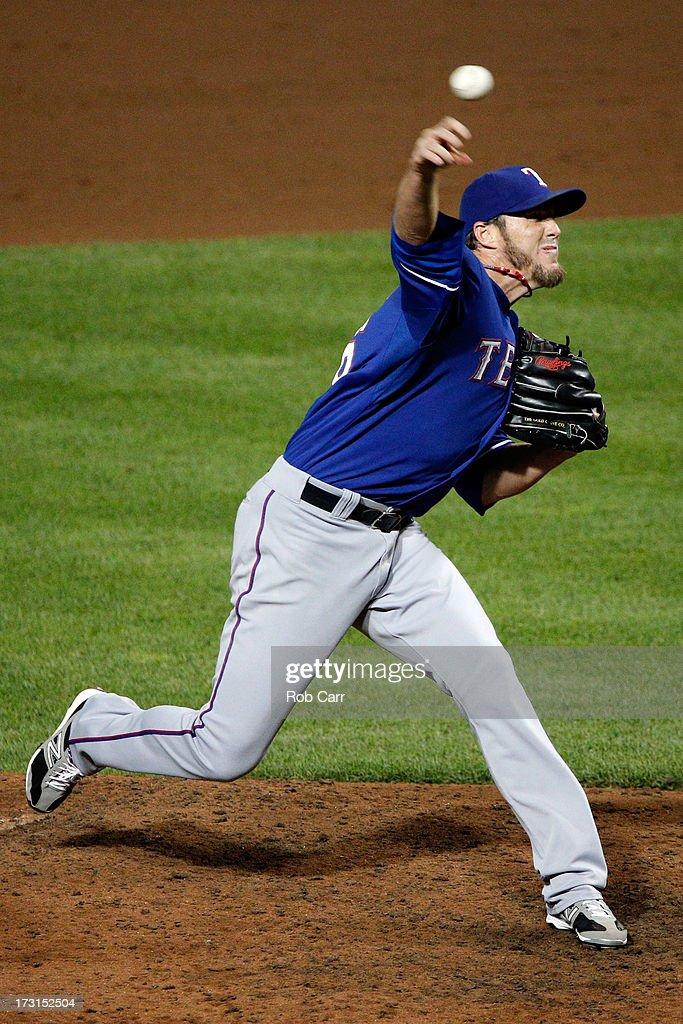 Relief pitcher <a gi-track='captionPersonalityLinkClicked' href=/galleries/search?phrase=Joe+Nathan&family=editorial&specificpeople=215405 ng-click='$event.stopPropagation()'>Joe Nathan</a> #36 of the Texas Rangers throws to a Baltimore Orioles batter during the ninth inning of the Rangers 8-5 win at Oriole Park at Camden Yards on July 8, 2013 in Baltimore, Maryland.