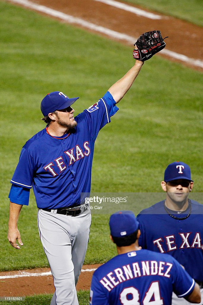 Relief pitcher <a gi-track='captionPersonalityLinkClicked' href=/galleries/search?phrase=Joe+Nathan&family=editorial&specificpeople=215405 ng-click='$event.stopPropagation()'>Joe Nathan</a> #36 of the Texas Rangers waves to the crowd after the Rangers defeated the Baltimore Orioles 8-5 at Oriole Park at Camden Yards on July 8, 2013 in Baltimore, Maryland.