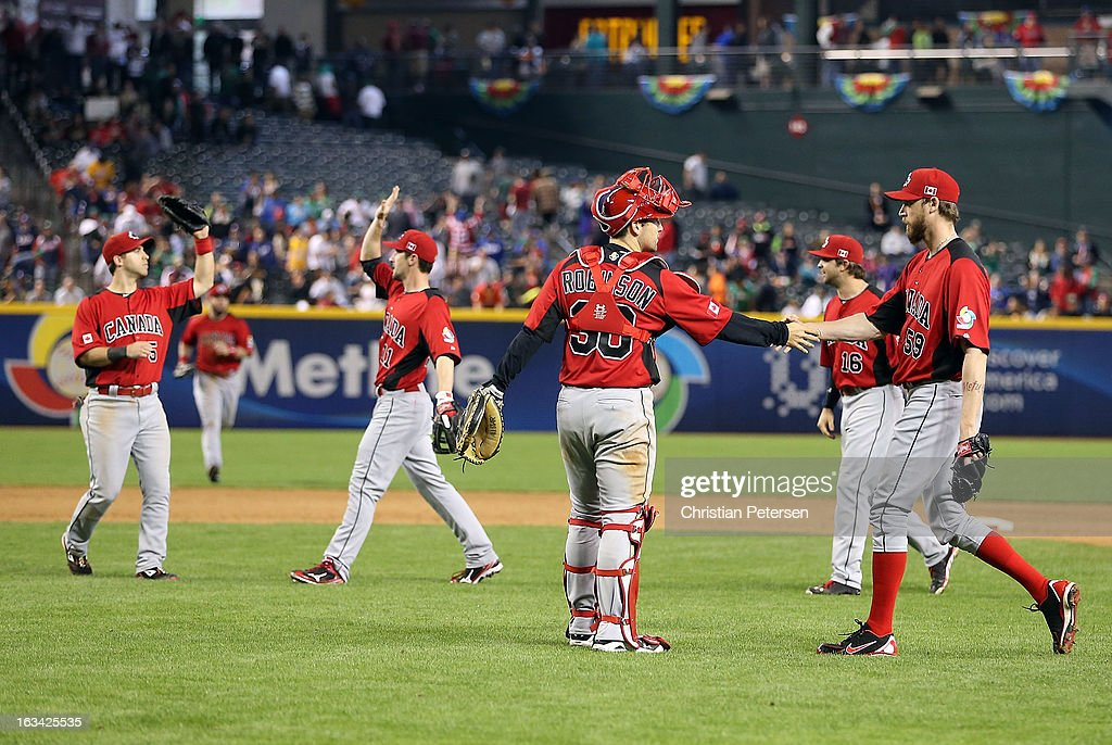 Relief pitcher <a gi-track='captionPersonalityLinkClicked' href=/galleries/search?phrase=John+Axford&family=editorial&specificpeople=6825257 ng-click='$event.stopPropagation()'>John Axford</a> #59 of Canada celebrates with catcher Chris Robinson #30 after defeating Mexico in the World Baseball Classic First Round Group D game at Chase Field on March 9, 2013 in Phoenix, Arizona. Canada defeated Mexico 10-3.