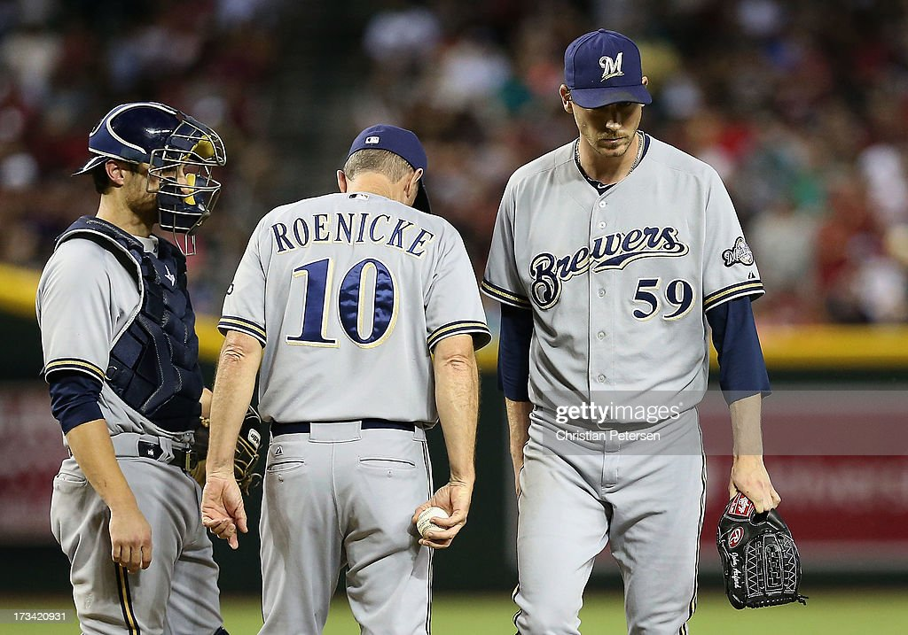 Relief pitcher <a gi-track='captionPersonalityLinkClicked' href=/galleries/search?phrase=John+Axford&family=editorial&specificpeople=6825257 ng-click='$event.stopPropagation()'>John Axford</a> #59 of the Milwaukee Brewers is removed by manager manager <a gi-track='captionPersonalityLinkClicked' href=/galleries/search?phrase=Ron+Roenicke&family=editorial&specificpeople=835989 ng-click='$event.stopPropagation()'>Ron Roenicke</a> #10 during the seventh inning of the MLB game against the Arizona Diamondbacks at Chase Field on July 13, 2013 in Phoenix, Arizona.