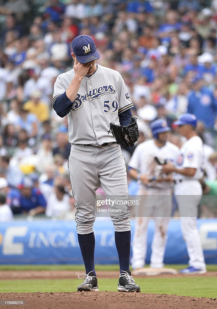 Relief pitcher <a gi-track='captionPersonalityLinkClicked' href=/galleries/search?phrase=John+Axford&family=editorial&specificpeople=6825257 ng-click='$event.stopPropagation()'>John Axford</a> #59 of the Milwaukee Brewers stands on the mound during the fifth inning against the Chicago Cubs at Wrigley Field on July 30, 2013 in Chicago, Illinois.