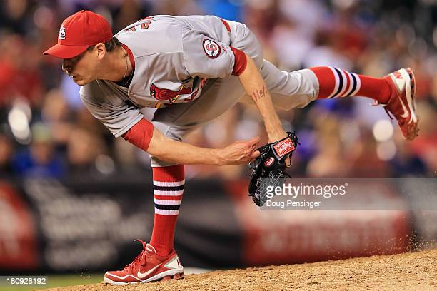 Relief pitcher John Axford of the St Louis Cardinals delivers against the Colorado Rockies at Coors Field on September 17 2013 in Denver Colorado The...