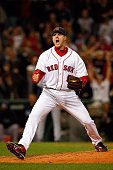 Relief pitcher Jonathan Papelbon of the Boston Red Sox reacts after an inning ending strike out in the eighth innning against the Tampa Bay Rays in...