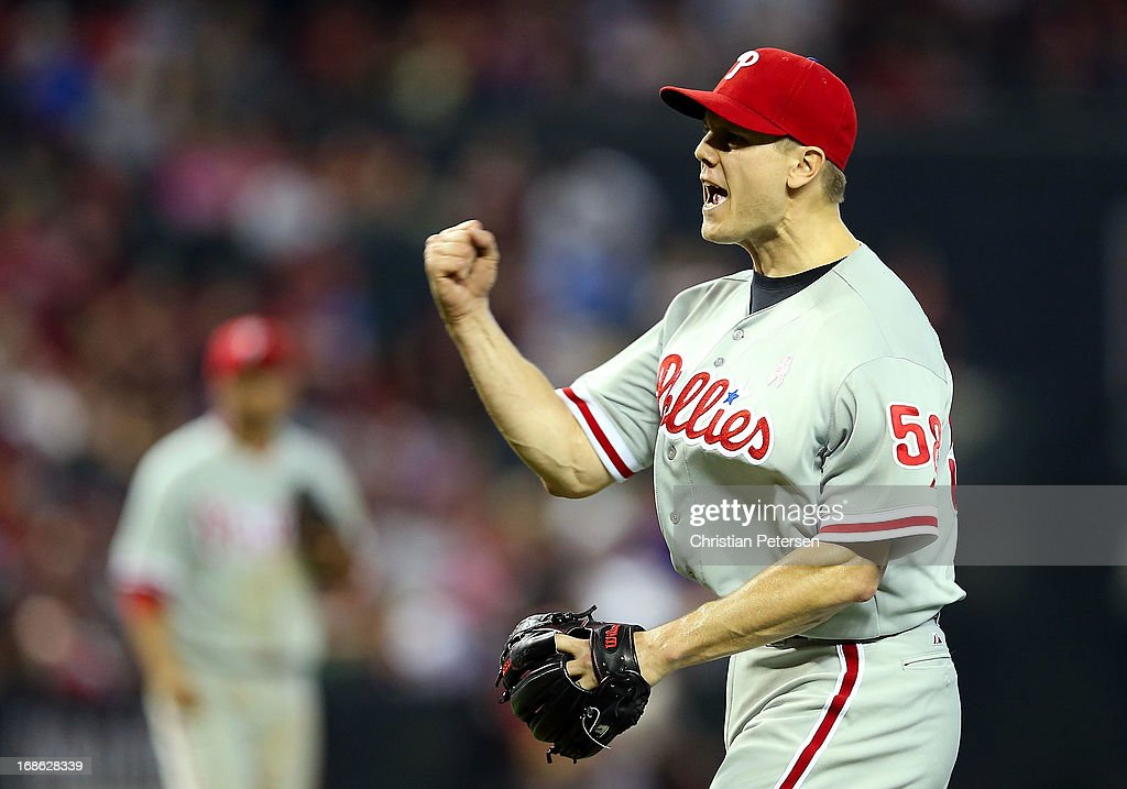Relief pitcher <a gi-track='captionPersonalityLinkClicked' href=/galleries/search?phrase=Jonathan+Papelbon&family=editorial&specificpeople=453535 ng-click='$event.stopPropagation()'>Jonathan Papelbon</a> #58 of the Philadelphia Phillies celebrates after defeating the Arizona Diamondbacks 4-2 in the 10th inning of the MLB game at Chase Field on May 12, 2013 in Phoenix, Arizona.