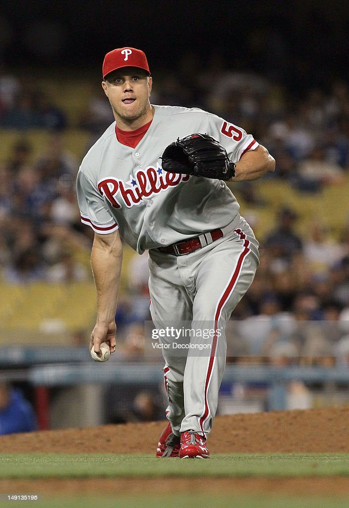 Relief Pitcher <a gi-track='captionPersonalityLinkClicked' href=/galleries/search?phrase=Jonathan+Papelbon&family=editorial&specificpeople=453535 ng-click='$event.stopPropagation()'>Jonathan Papelbon</a> #58 of the Philadelphia Phillies tosses the ball to first base for the first out in the ninth inning during the MLB game against the Los Angeles Dodgers at Dodger Stadium on July 17, 2012 in Los Angeles, California. The Phillies defeated the Dodgers 3-2.
