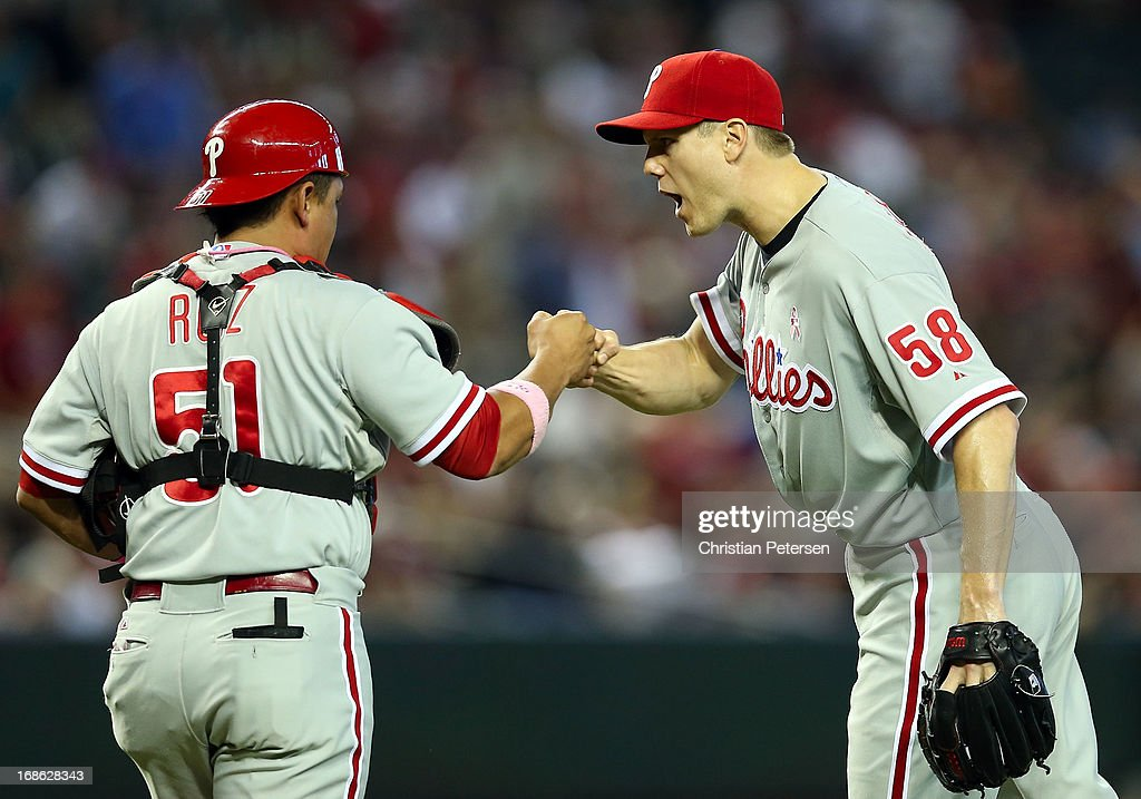 Relief pitcher Jonathan Papelbon #58 of the Philadelphia Phillies celebrates with catcher Carlos Ruiz #51 after defeating the Arizona Diamondbacks 4-2 in the 10th inning of the MLB game at Chase Field on May 12, 2013 in Phoenix, Arizona.
