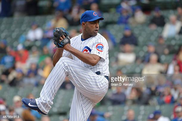 Relief pitcher Jose Veras of the Chicago Cubs pitches during the eighth inning against the Arizona Diamondbacks at Wrigley Field on April 24 2014 in...