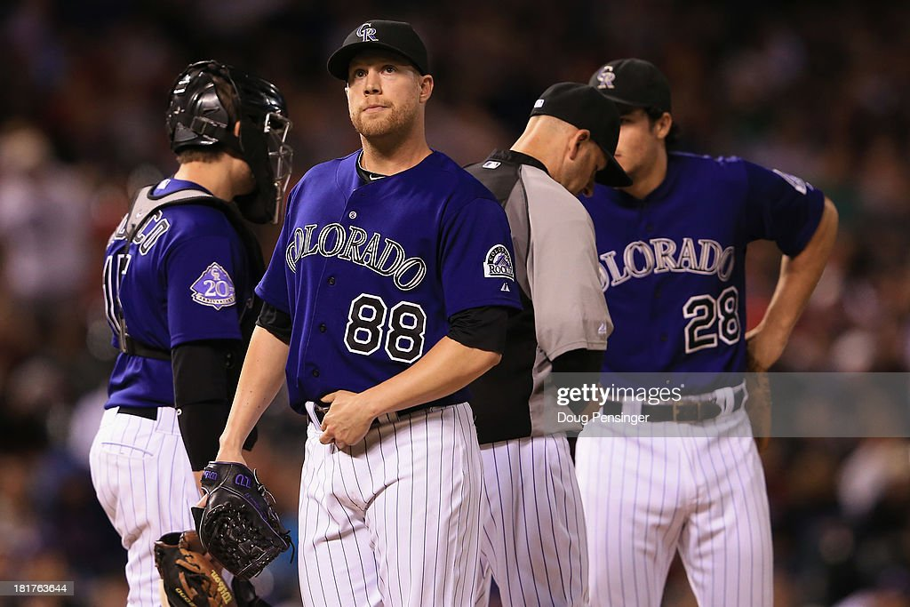 Relief pitcher <a gi-track='captionPersonalityLinkClicked' href=/galleries/search?phrase=Josh+Outman&family=editorial&specificpeople=4900182 ng-click='$event.stopPropagation()'>Josh Outman</a> #88 of the Colorado Rockies is removed from the game by manager Walt Weiss #22 of the Colorado Rockies in the ninth inning against the Boston Red Sox at Coors Field on September 24, 2013 in Denver, Colorado. The Rockies defeated the Red Sox 8-3.