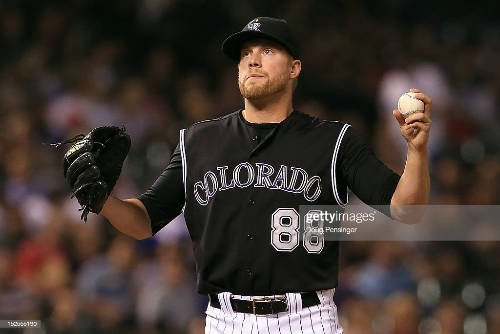 Relief pitcher <a gi-track='captionPersonalityLinkClicked' href=/galleries/search?phrase=Josh+Outman&family=editorial&specificpeople=4900182 ng-click='$event.stopPropagation()'>Josh Outman</a> #88 of the Colorado Rockies reacts after giving up a two run homerun to Adam Eaton of the Arizona Diamondbacks in the sixth inning at Coors Field on September 21, 2012 in Denver, Colorado.