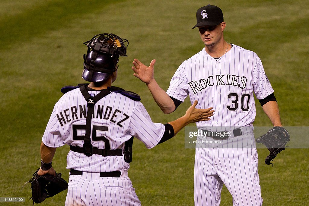 Relief pitcher Josh Roenicke #30 of the Colorado Rockies celebrates the 6-2 victory against the Philadelphia Phillies with catcher <a gi-track='captionPersonalityLinkClicked' href=/galleries/search?phrase=Ramon+Hernandez&family=editorial&specificpeople=179461 ng-click='$event.stopPropagation()'>Ramon Hernandez</a> #55 at Coors Field on July 13, 2012 in Denver, Colorado.