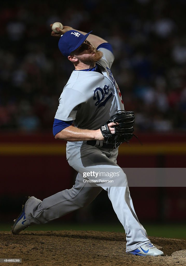 Relief pitcher J.P. Howell #56 of the Los Angeles Dodgers pitches against the Arizona Diamondbacks during the MLB game at Chase Field on April 13, 2014 in Phoenix, Arizona. The Dodgers defeated the Diamondbacks 8-6.
